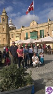 Students learning English in Malta at Marsaxlokk fishing village on a Sunday excursion